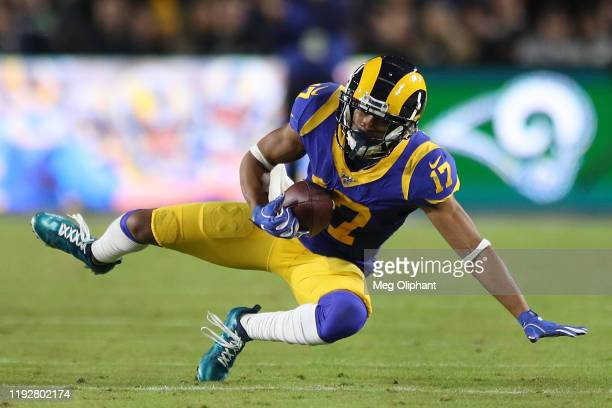 Wide receiver Robert Woods of the Los Angeles Rams completes a catch over the defense of the Seattle Seahawks during the game at Los Angeles Memorial...