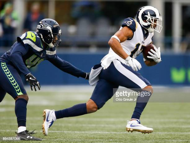Wide receiver Robert Woods of the Los Angeles Rams escapes cornerback Byron Maxwell of the Seattle Seahawks during the 2nd quarter of the game at...