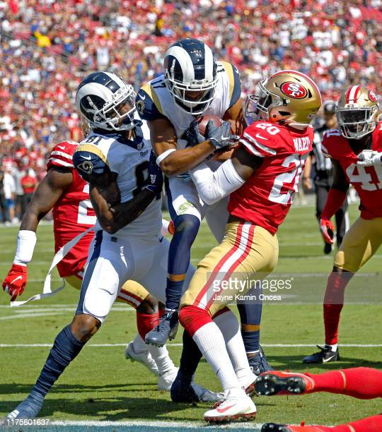 Wide receiver Robert Woods of the Los Angeles Rams gets into the end zone for a touchdown past cornerback Jimmie Ward of the San Francisco 49ers with...