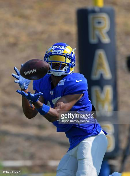 Wide receiver Robert Woods of the Los Angeles Rams hands on to a pass during training camp on August 19, 2020 at the practice facility at in Thousand...