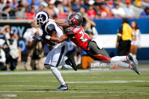 Wide receiver Robert Woods of the Los Angeles Rams is defended by cornerback Vernon III Hargreaves of the Tampa Bay Buccaneers during the first...