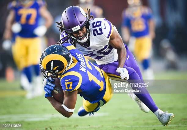 Wide receiver Robert Woods of the Los Angeles Rams is tackled by cornerback Trae Waynes of the Minnesota Vikings at Los Angeles Memorial Coliseum on...