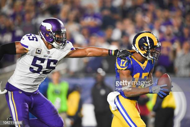 Wide receiver Robert Woods of the Los Angeles Rams makes a catch in front of linebacker Anthony Barr of the Minnesota Vikings for a touchdown to lead...