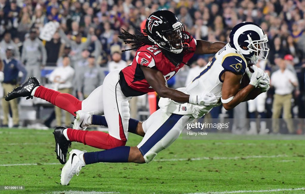 Wide receiver Robert Woods #17 of the Los Angeles Rams makes a catch in front of cornerback Desmond Trufant #21 of the Atlanta Falcons during the second quarter of the NFC Wild Card Playoff game at Los Angeles Coliseum on January 6, 2018 in Los Angeles, California.