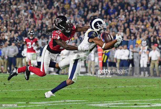 Wide receiver Robert Woods of the Los Angeles Rams makes a catch in front of cornerback Desmond Trufant of the Atlanta Falcons during the second...