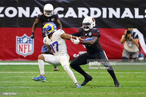 Wide receiver Robert Woods of the Los Angeles Rams makes a reception as outside linebacker De'Vondre Campbell of the Arizona Cardinals defends during...
