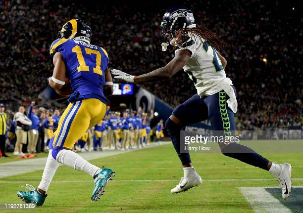 Wide receiver Robert Woods of the Los Angeles Rams makes a touchdown catch over cornerback Shaquill Griffin of the Seattle Seahawks in the second...