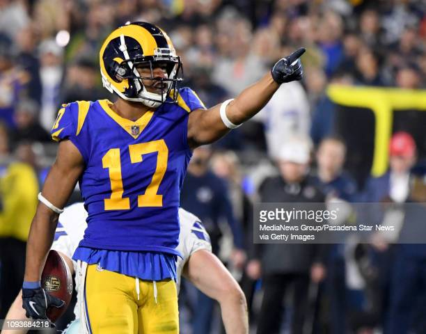 d44783442 Wide receiver Robert Woods of the Los Angeles Rams reacts after a first  down catch against