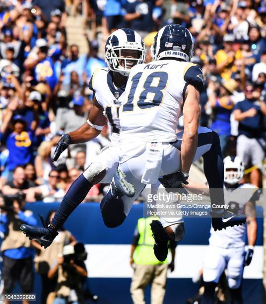 Wide receiver Robert Woods of the Los Angeles Rams reacts with teammate wide receiver Cooper Kupp after catching a pass for a touchdown against the...