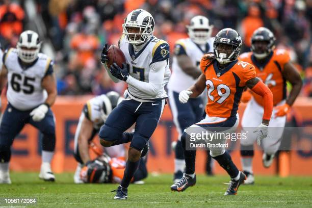 Wide receiver Robert Woods of the Los Angeles Rams runs after a catch against the Denver Broncos in the first quarter of a game against the Denver...