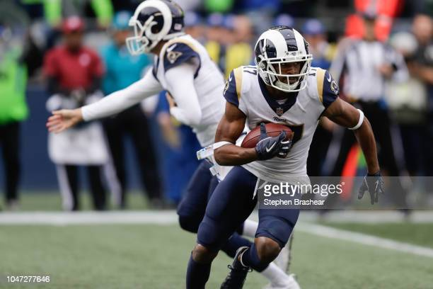 Wide receiver Robert Woods of the Los Angeles Rams runs the ball after a catch in the second half against the Seattle Seahawks at CenturyLink Field...