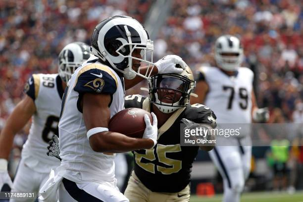 Wide receiver Robert Woods of the Los Angeles Rams runs with the ball after catching the pass in the first quarter in front of cornerback Eli Apple...