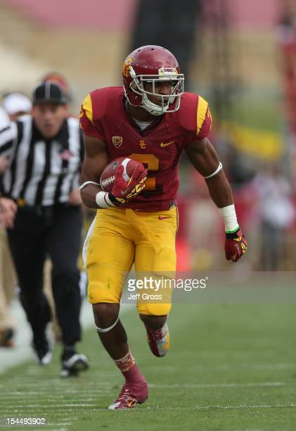 Wide receiver Robert Woods of the USC Trojans carries the ball against the Colorado Buffaloes at Los Angeles Memorial Coliseum on October 20, 2012 in...
