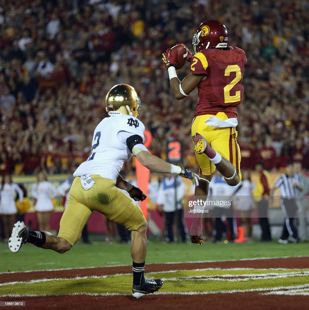Wide receiver Robert Woods #2 of the USC Trojans catches a pass for a touchdown while pursued by cornerback Bennett Jackson #2 of the Notre Dame Fighting Irish in the first half at Los Angeles Memorial Coliseum on November 24, 2012 in Los Angeles, California.