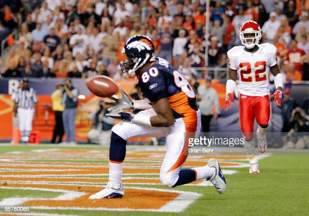 Wide receiver Rod Smith of the Denver Broncos catches a 12-yard touchdown pass against the Kansas City Chiefs in the first quarter September 26, 2005...