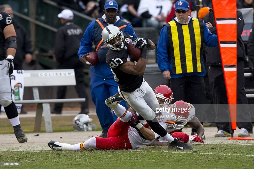 Wide receiver Rod Streater #80 of the Oakland Raiders is tackled by free safety Tysyn Hartman #31 of the Kansas City Chiefs after a pass reception during the second quarter at O.co Coliseum on December 16, 2012 in Oakland, California.