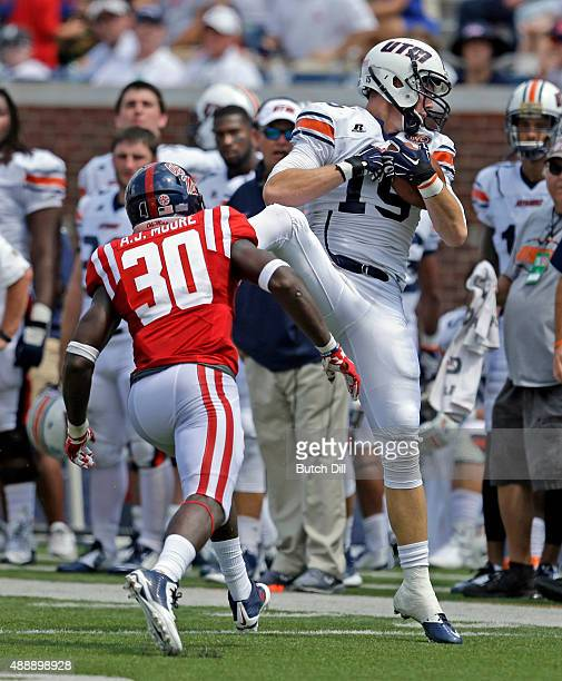 Wide receiver Rod Wright of the Tennessee Martin Skyhawks catches a pass over defensive back AJ Moore of the Mississippi Rebels during the second...