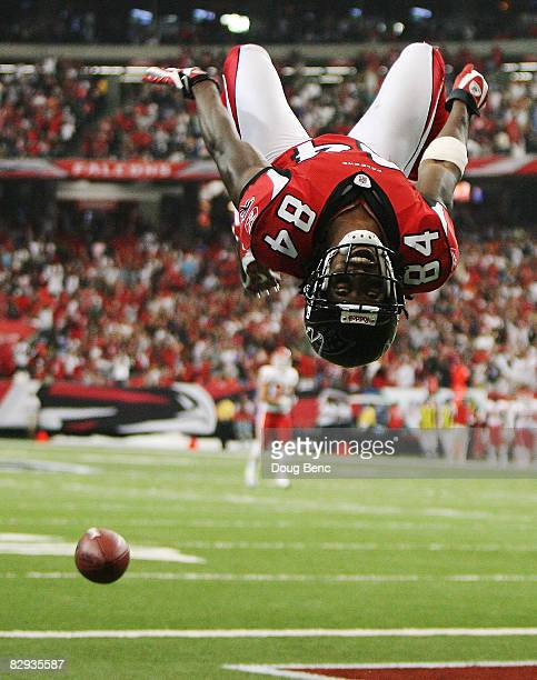 Wide receiver Roddy White of the Atlanta Falcons does a back-flip to celebrate his touchdown in the first quarter against the Kansas City Chiefs at...