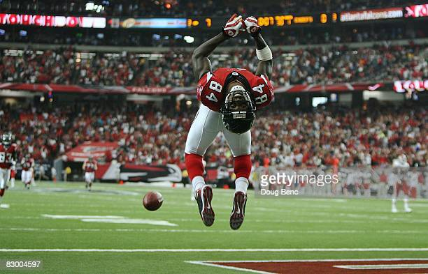 Wide receiver Roddy White of the Atlanta Falcons does a backflip to celebrate his touchdown in the first quarter against the Kansas City Chiefs at...