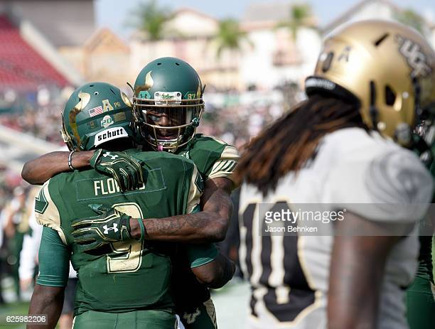 Wide receiver Rodney Adams congratulates quarterback Quinton Flowers of the South Florida Bulls after Flowers ran for a touchdown against the UCF...