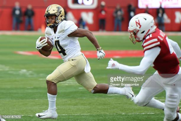 Wide receiver Rondale Moore of the Purdue Boilermakers runs from defensive back Deontai Williams of the Nebraska Cornhuskers in the first half at...