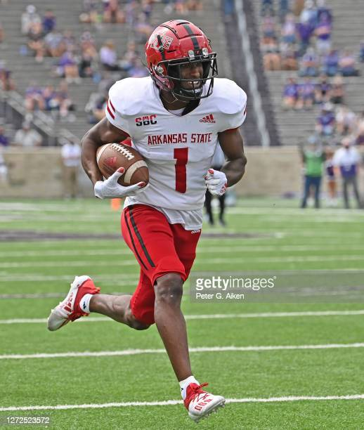 Wide receiver Roshauud Paul of the Arkansas State Red Wolves rushes for touchdown against the Kansas State Wildcats, during the first half at Bill...