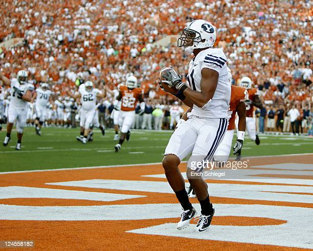 Wide receiver Ross Apo of the BYU Cougars catches a second quarter touchdown pass by Jake Heaps against the Texas Longhorns on September 10, 2011 at...