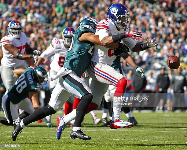 Wide receiver Rueben Randle of the New York Giants can't can't make a catch as safety Nate Allen of the Philadelphia Eagles hits him in the first...