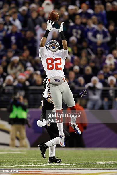 Wide receiver Rueben Randle of the New York Giants catches a pass in front of cornerback Cary Williams of the Baltimore Ravens at MT Bank Stadium on...