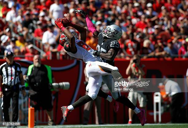 Wide receiver Russell Shepard of the Tampa Bay Buccaneers hauls in a 19 yard pass from quarterback Jameis Winston in front of cornerback D.J. Hayden...