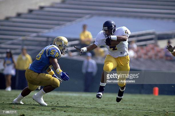 Wide receiver Russell White of the University of California Golden Bears carries the ball against the University of California at Los Angeles Bruins...