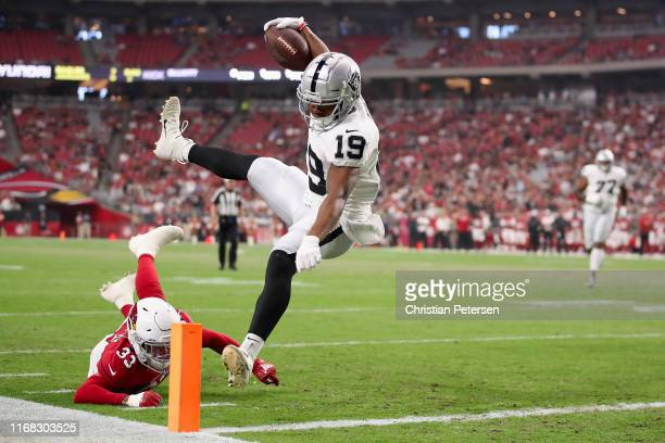 Wide receiver Ryan Grant of the Oakland Raiders dives into the end zone to score a 13-yard touchdown past cornerback Byron Murphy of the Arizona...