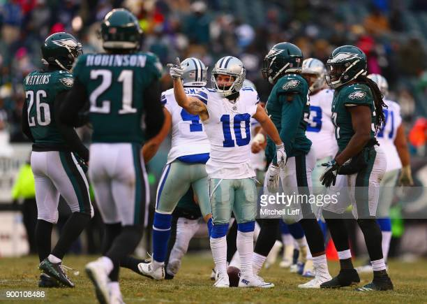 Wide receiver Ryan Switzer of the Dallas Cowboys points for a firstdown after catching a pass on a thirddown against the Philadelphia Eagles during...