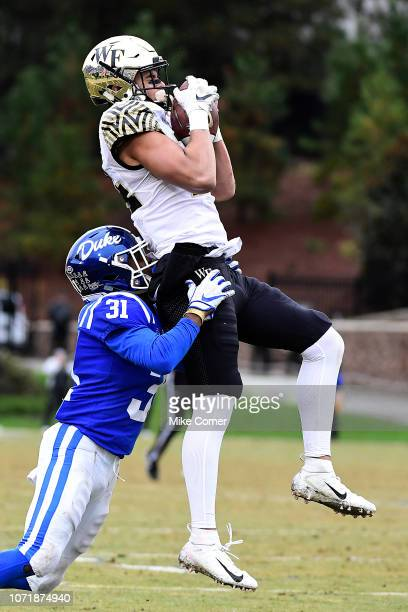 Wide receiver Sage Surratt of the Wake Forest Demon Deacons elevates over cornerback Josh Blackwell of the Duke Blue Devils for a reception during...