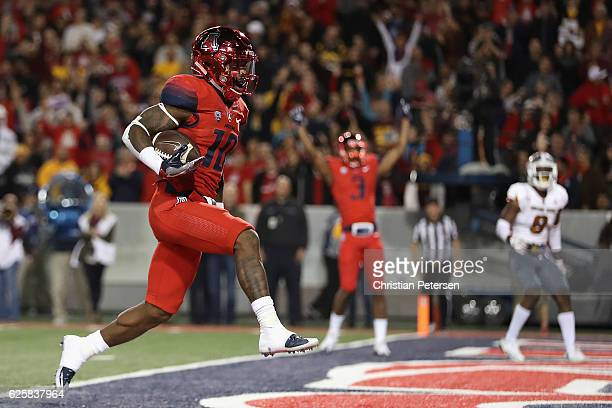 Wide receiver Samajie Grant of the Arizona Wildcats scores a nine yard rushing touchdown against the Arizona State Sun Devils during the third...