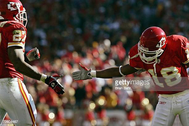 Wide receiver Samie Parker of the Kansas City Chiefs congratulates running back Larry Johnson on picking up a first down on a long run against the...