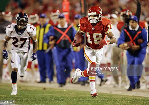 Wide receiver Samie Parker of the Kansas City Chiefs picks up a first down and then some against cornerback Darrent Williams of the Denver Broncos in...