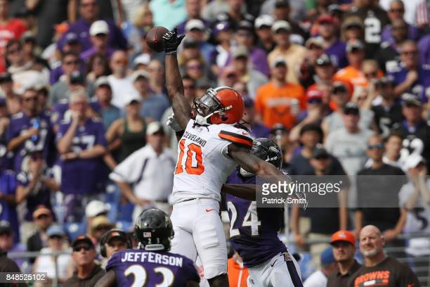 Wide receiver Sammie Coates of the Cleveland Browns and cornerback Brandon Carr of the Baltimore Ravens fight for the ball in the third quarter at MT...