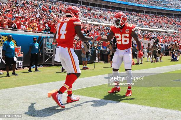 Wide receiver Sammy Watkins celebrates his touchdown with running back Damien Williams of the Kansas City Chiefs in the first quarter of the game...