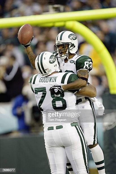 Wide receiver Santana Moss of the New York Jets celebrates with teammate Jonathan Goodwin after scoring on a 60yard touchdown reception during the...