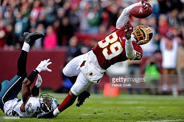 Wide receiver Santana Moss of the Washington Redskins dives into the end zone past cornerback Brandon Boykin of the Philadelphia Eagles to score a...
