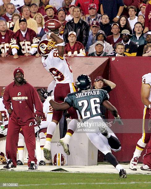 Wide receiver Santana Moss of the Washington Redskins leaps to catch a pass against Lito Sheppard of the Philadelphia Eagles on November 6 2005 at...