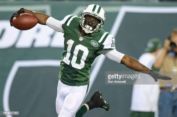 Wide receiver Santonio Holmes of the New York Jets celebrates after his 69 yard touchdown catch in the 2nd half of the Jets 2720 win over the Buffalo...