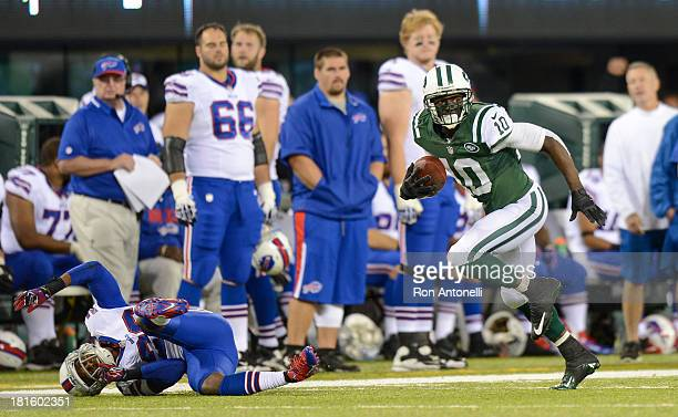 Wide receiver Santonio Holmes of the New York Jets runs after the catch for a 69 yard touchdown in the 2nd half of the Jets 2720 win over the Buffalo...