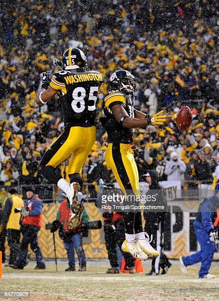 Wide receiver Santonio Holmes of the Pittsburgh Steelers celebrates with wide receiver Nate Washington after returning a punt for a touchdown against...