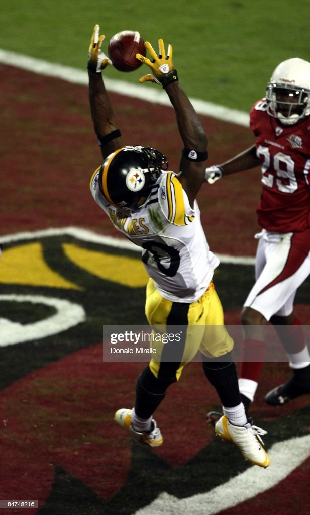 Wide Receiver Santonio Holmes #10 of the Pittsburgh Steelers jumps up for a pass in the endzone against Rogers-Cromartie #29 of the Arizona Cardinals during Super Bowl XLIII at Raymond James Stadium on February 1, 2009 in Tampa, Florida. Santonio Holmes was named MVP of the game.