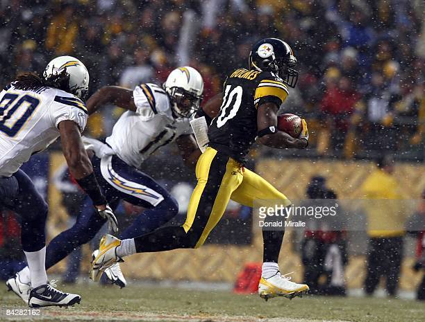 Wide Receiver Santonio Holmes of the Pittsburgh Steelers runs back a punt return for a touchdown en route to his team's 3524 victory over the San...