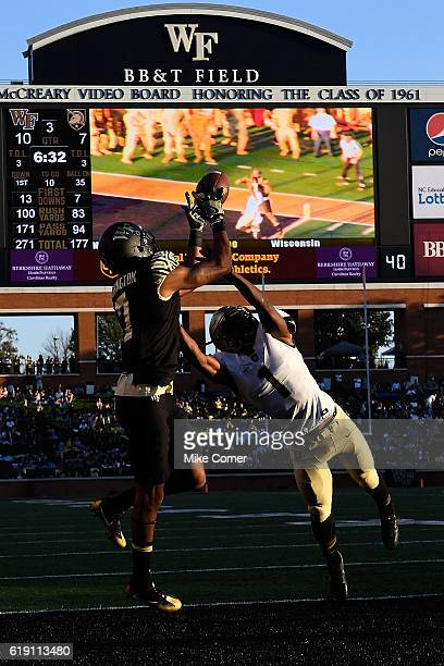 Wide receiver Scotty Washington of the Wake Forest Demon Deacons attempts a catch against the Army Black Knights at BBT Field on October 29 2016 in...