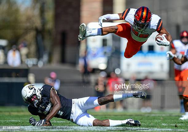 Wide receiver Seth Collins of the Oregon State Beavers goes airborne after being hit by defensive back Afolabi Laguda of the Colorado Buffaloes in...