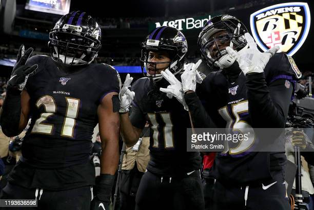 Wide receiver Seth Roberts of the Baltimore Ravens and teammates running back Mark Ingram and wide receiver Marquise Brown celebrate Roberts'...